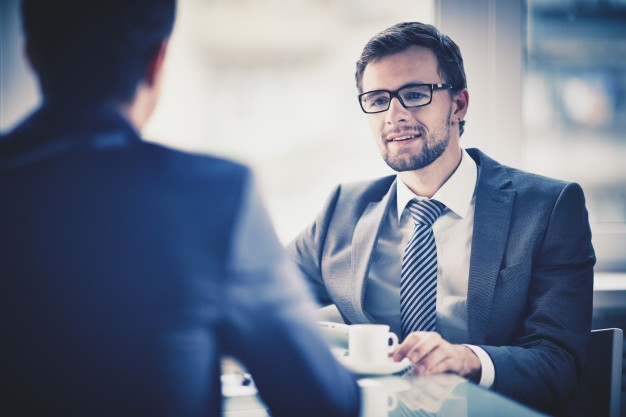 worker drinking a cup of coffee with a colleague 1098 3956 - The Importance of Discussion: Why Talking About Politics Is Important